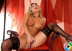 Sexy blonde in thigh high nylons and platform stripper heels